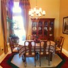 The dining room was overpowered with patterns, which close in the space